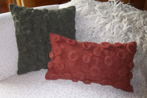 felted pillows made with alpaca yarn by woollymama fiber arts